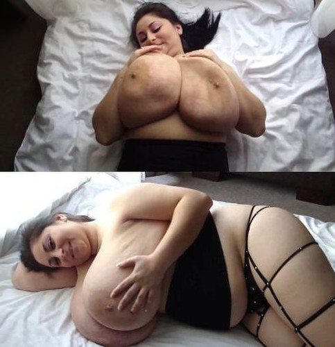 Unbelievably Boobed Woman Jiggling On Bed